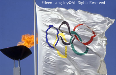 The Olympic Flag and Flame at the 1992 Barcelona Olympic Games.